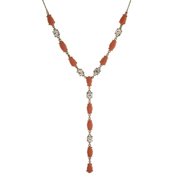 "Burnished gold tone necklace with epoxy stones and clear rhinestones. Adjustable up to 28"" in length."