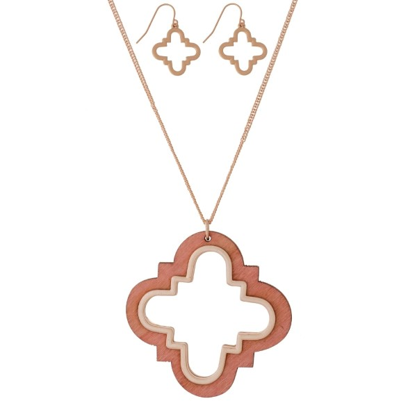 """Long, dainty necklace set with a wooden, quatrefoil shaped pendant and matching stud earrings. Approximately 32"""" in length."""