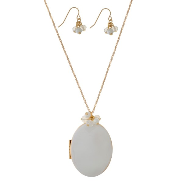 "Dainty, gold tone necklace set with a locket pendant. Approximately 30"" in length."