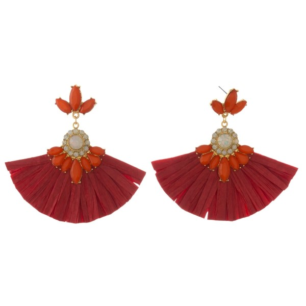 """Gold tone post earring with rhinestone details and raffia fan. Approximately 3"""" long."""