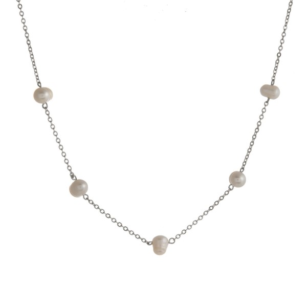 "Metal necklace with pearl details. Approximately 22"" in length"