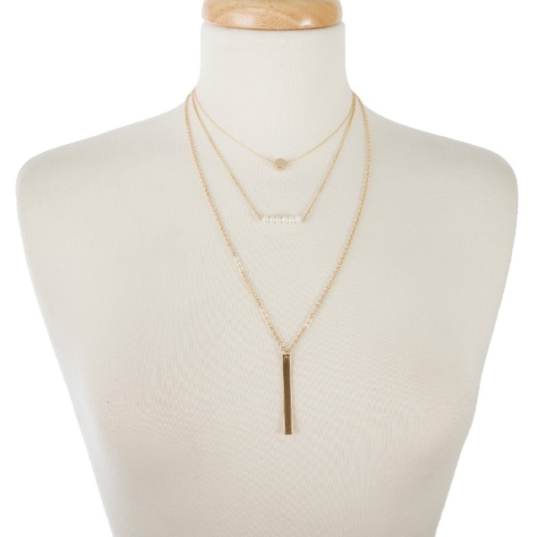 "Dainty, metal necklaces with circle, pearl and a bar pendant. Approximately 14"" to 20"" in length."