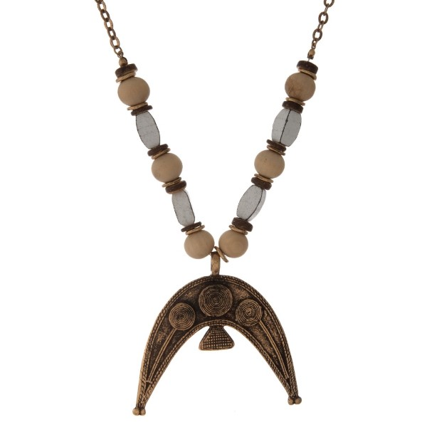 """Metal necklace with wooden beads and crescent pendant. Approximately 26"""" in length."""