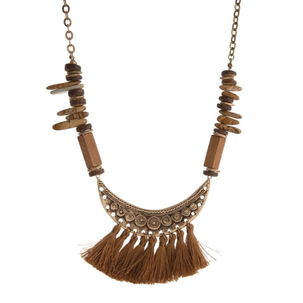 """Long necklace with boho pendant and natural stone beads. Approximately 30"""" in length."""