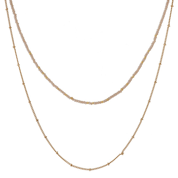"""Dainty, two layer, gold tone necklace with a faceted bead layer. Approximately 12"""" and 16"""" in length."""