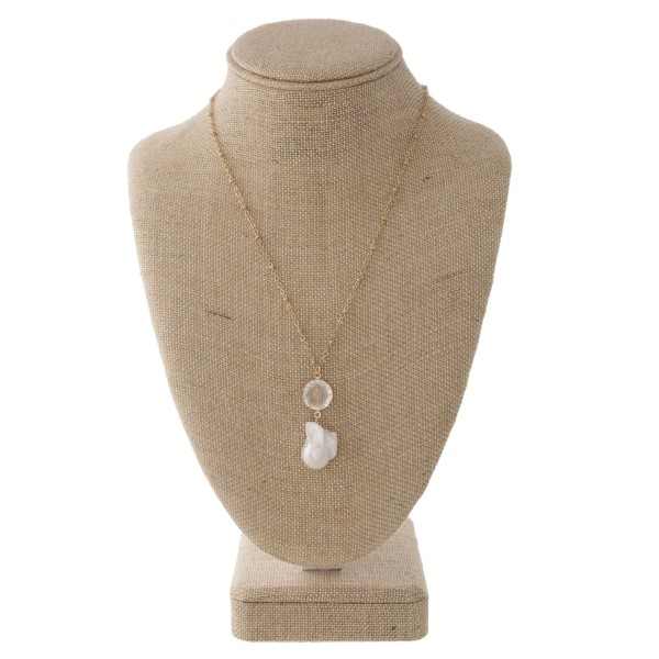 "Gold tone pearl necklace with freshwater pearl and crystal detail. Approximately 18"" in length."