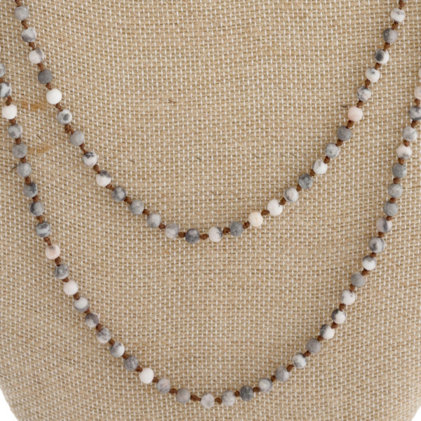 "Long necklace with natural stone beads. Approximately 60"" in length."