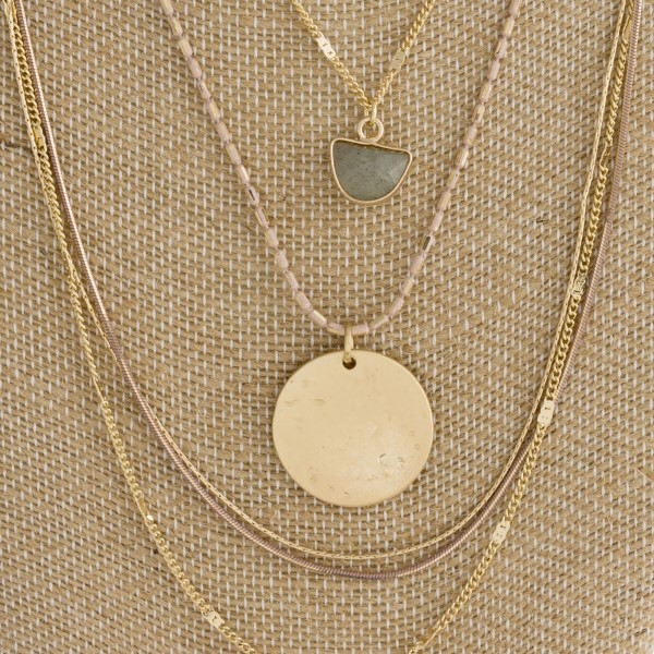 "Gold tone layered necklace with hammered and natural stone pendant. Approximately 16-20"" in length."