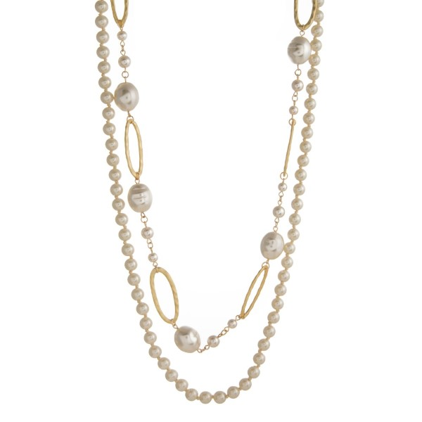 """Long metal necklace with pearl details. Approximately 32"""" in length."""