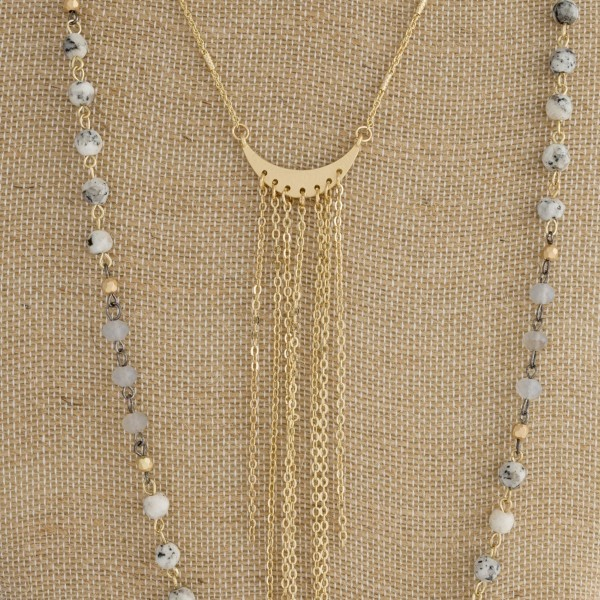 """Long layered necklace with natural stone beads and metal focal. Approximately 28"""" in length."""
