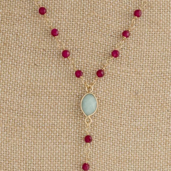 "Y necklace with faceted beads and natural stone. Approximately 20"" in length."