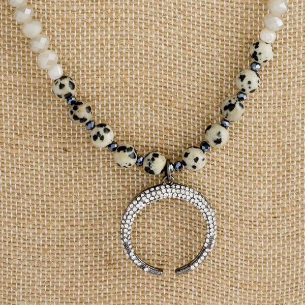 """Long necklace with faceted and natural stone beads and horn pendant. Approximately 30"""" in length."""