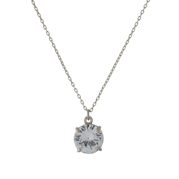 """Dainty, silver tone necklace with a CZ rhinestone pendant. Approximately 16"""" in length."""