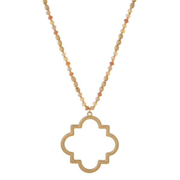 """Faceted and gold tone beaded necklace with a quatrefoil pendant. Approximately 30"""" in length."""