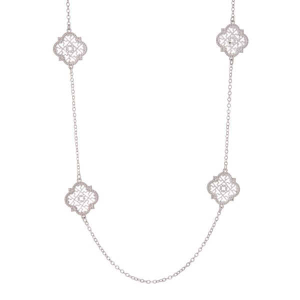 """Long, metal necklace with quatrefoil stationaries. Approximately 30"""" in length."""