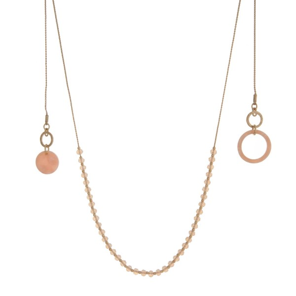 """Gold tone, adjustable necklace with faceted beads and acetate accents. Approximately 22"""" in length."""