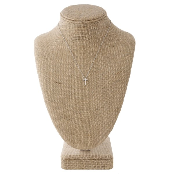 """Dainty metal necklace with cross charm. Approximately 16"""" in length with a 1/2"""" charm."""