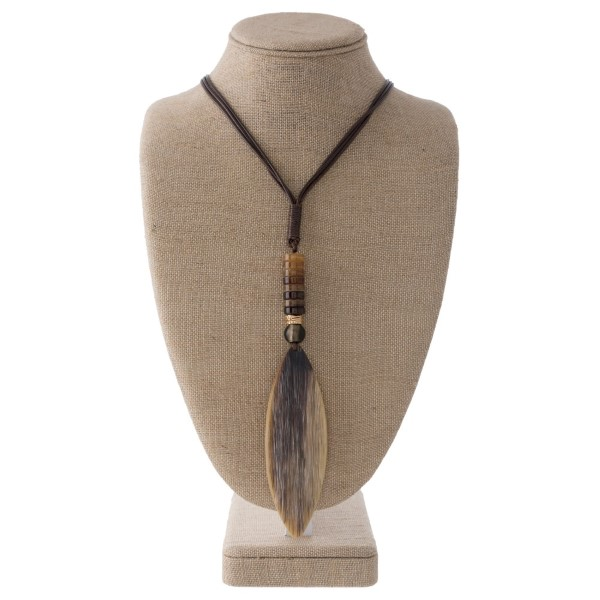 """Long leather cord necklace with acetate pendant. Approximately 4"""" in length."""
