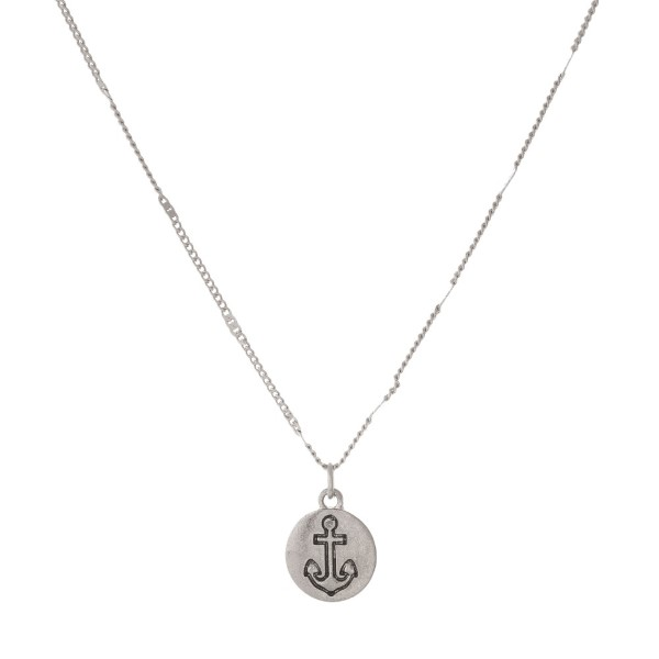 "Dainty, metal necklace with an anchor charm. Approximately 16"" in length."