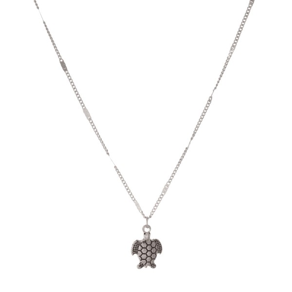 "Dainty, metal necklace with a turtle charm. Approximately 16"" in length."