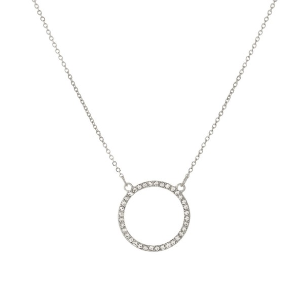 "Dainty, metal necklace with circle focal detailed with rhinestones. Approximately 16"" in length."