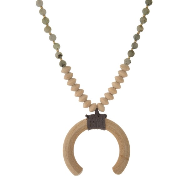 "Long necklace with wooden and natural stone beads and a wooden horn. Approximately 32"" in length."