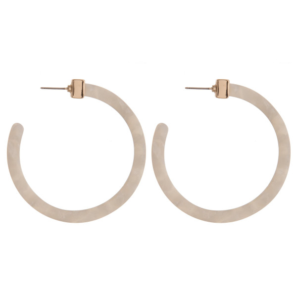 "Acetate hoop earring. Approximately 2"" in diameter."