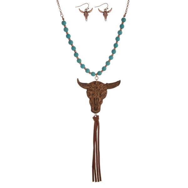 """Statement necklace set with a half beaded chain, leather steer head pendant, faux tassel pendant and matching fishhook earrings. Approximately 30"""" in length"""