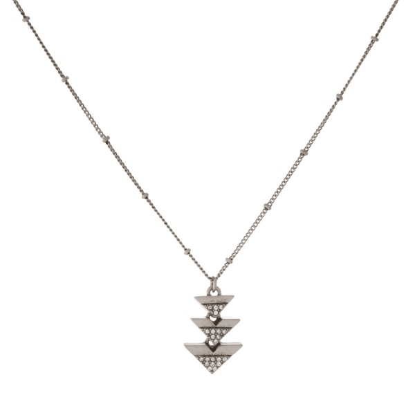 """Dainty necklace with stacked triangle charms. Approximately 16"""" in length."""