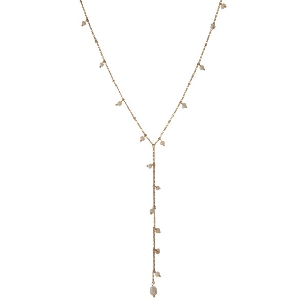 "Dainty Y necklace with pearl details. Approximately 18"" in length."