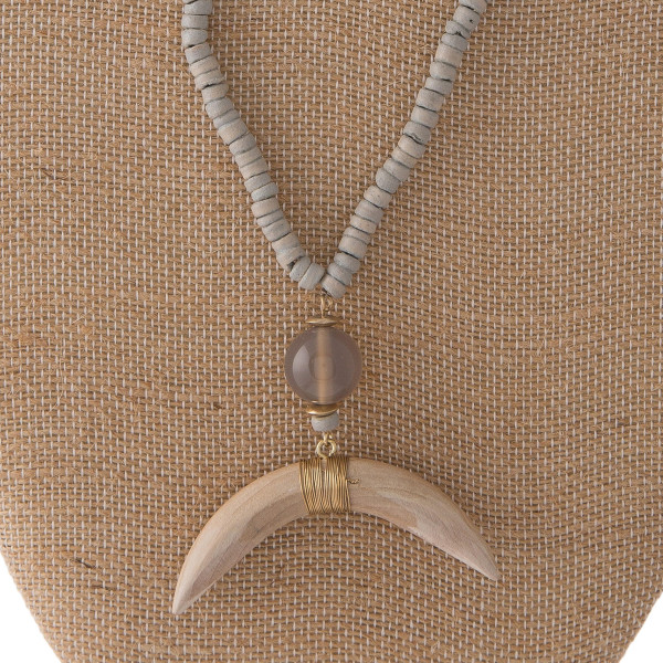 "Long wooden necklace with horn shaped pendant. Approximately 30"" in length."