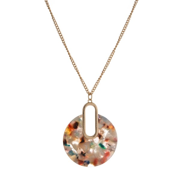 """Gold tone necklace with circle acetate pendant. Approximately 32"""" in length."""