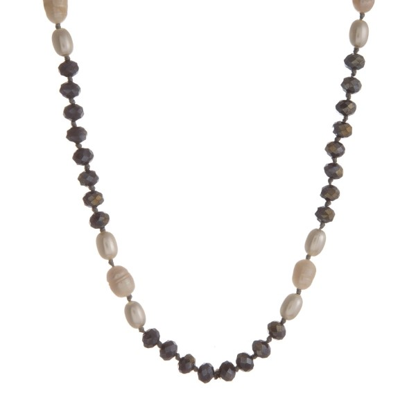 "Long necklace with freshwater pearls and faceted beads. Approximately 28"" in length."