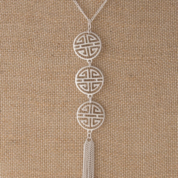"""Metal necklace with three boho pennants and metal tassel. Approximately 26"""" in length with a 4"""" tassel."""