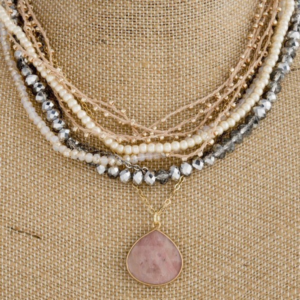 "Short layered necklace with faceted beads and natural stone detail. Approximately 18"" in length."