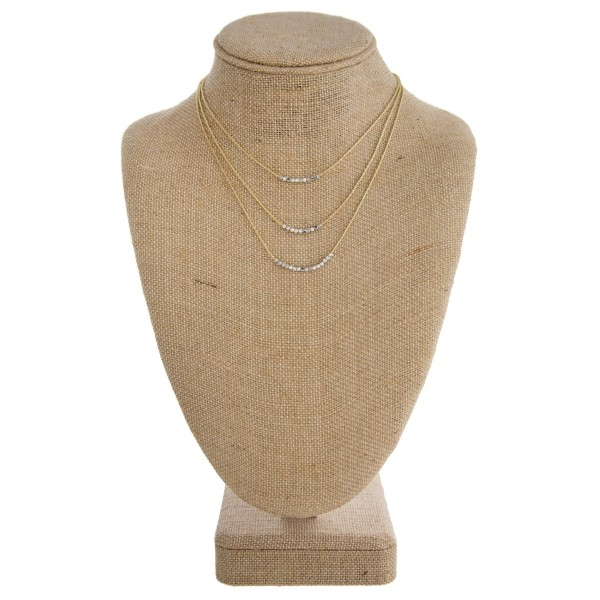 "Gold tone layered necklace with metal beads. Approximately 14""-18"" in length."
