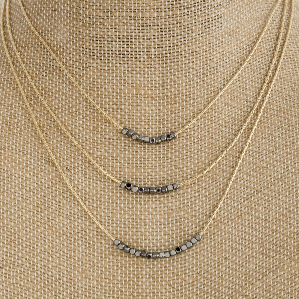 """Gold tone layered necklace with metal beads. Approximately 14""""-18"""" in length."""
