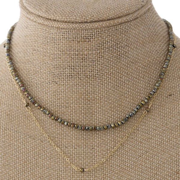"Short layered necklace with faceted beads. Approximately 16"" in length."