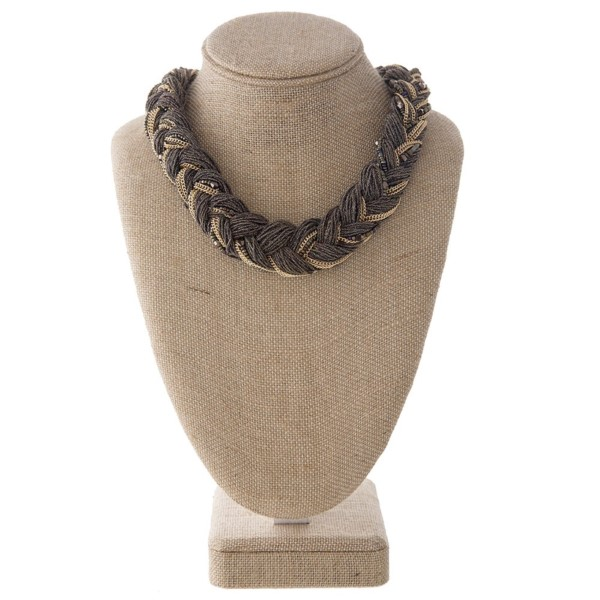 "Short necklace with braided metal detail. Approximately 18"" in length."