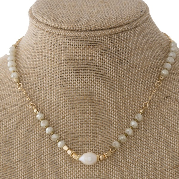 "Short gold tone necklace with pearl and faceted beads. Approximately 20"" in length."