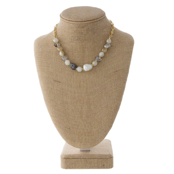 "Short necklace with natural stone and pearl detail. Approximately 18"" in length."