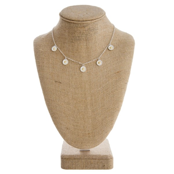 "Dainty metal necklace with two tone charm. Approximately 16"" in length."