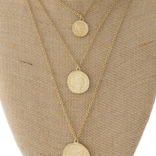 "Layered necklace with coin pendants. Approximately 16""-22"" in length."