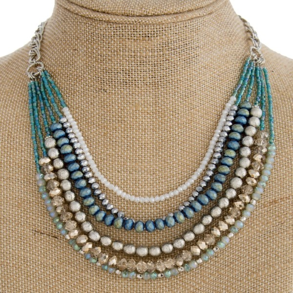 "Gold tone layered necklace with faceted beads. Approximately 20"" in length."