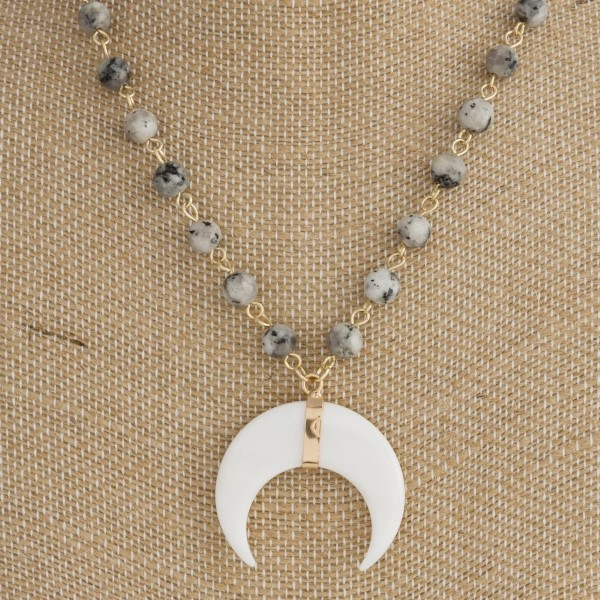 "Gold tone natural stone necklace with horn pendant. Approximately 20"" in length."