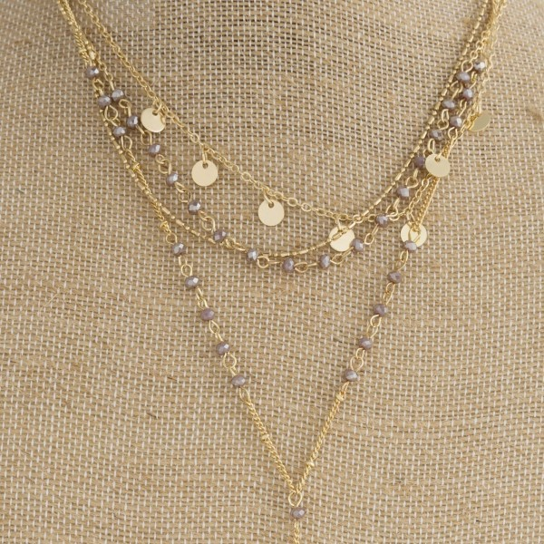 "Gold tone layered necklace with faceted beads and natural stone. Approximately 20"" in length."
