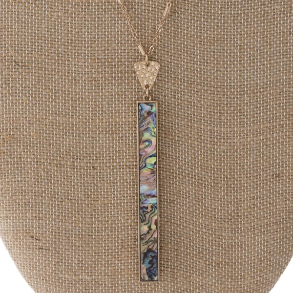 """Long gold tone necklace with natural stone pendant. Approximately 32"""" in length with a 3"""" pendant."""