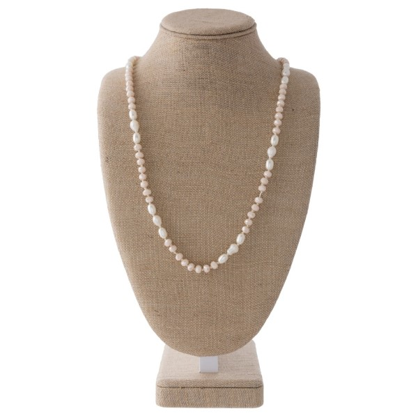 "Long necklace with pearls and faceted beads. Approximately 30"" in length."