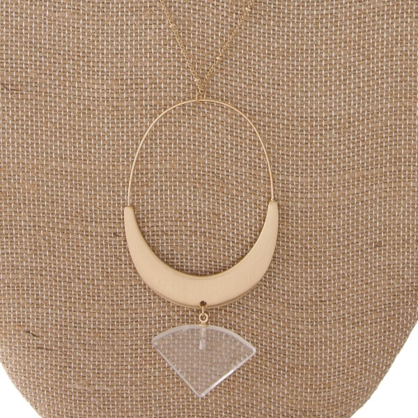 "Gold tone necklace with oval pendant with natural stone accents. Approximately 32"" in length with a 2.5"" pendant."