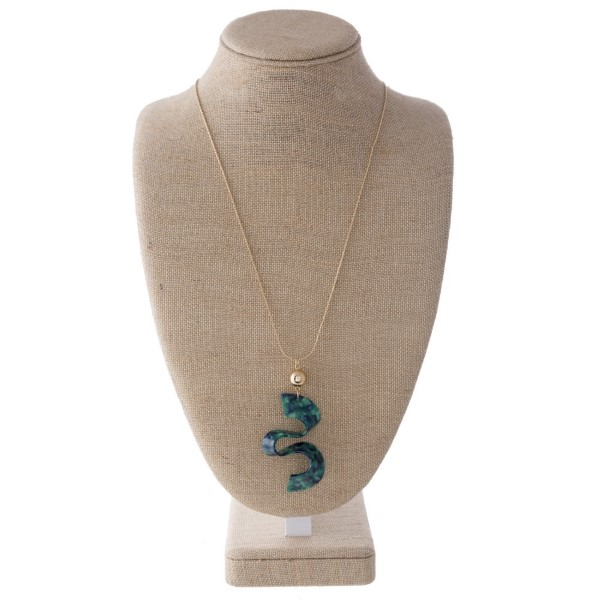 "Gold tone adjustable necklace with acetate squiggle shape. Approximately 30"" in length with a 3"" pendant."